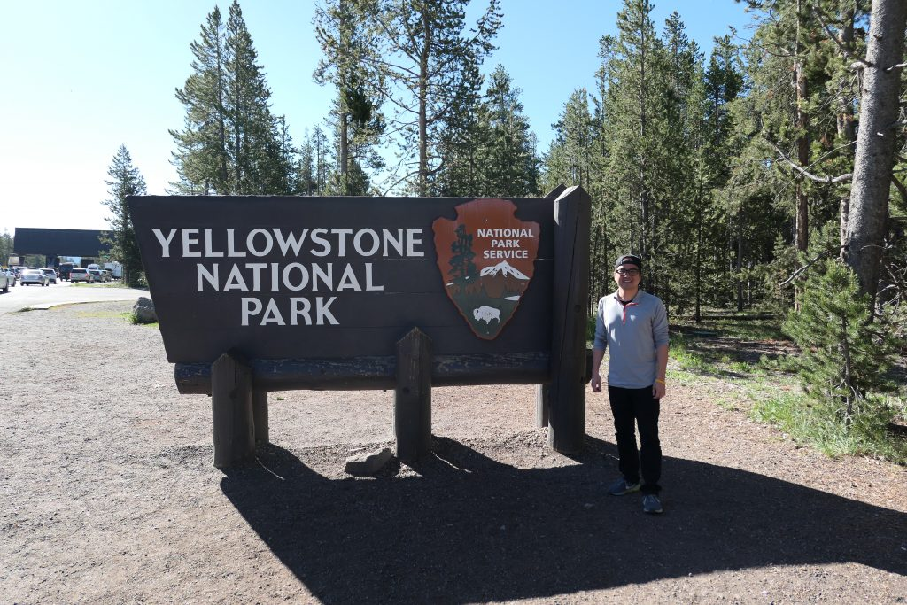 In front of Yellowstone sign